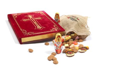Book of st nicholas and sweets all part of the traditional holiday of St Nicholas in the Netherlands and Belgium Stock Photo - 11269490
