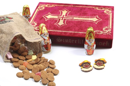 nicolaas: Book of Sinterklaas with candy in bag Stock Photo