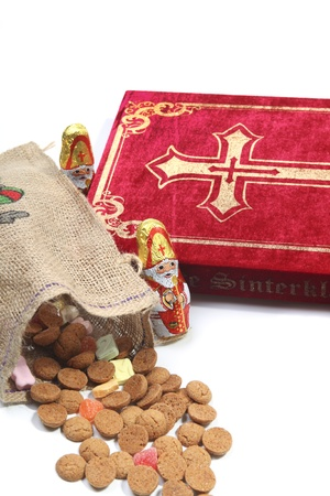 sint nicolaas: Book of Sinterklaas with candy in bag Stock Photo