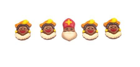 Row of chocolate Dutch Sinterklaas with his Piets Stock Photo - 11534395