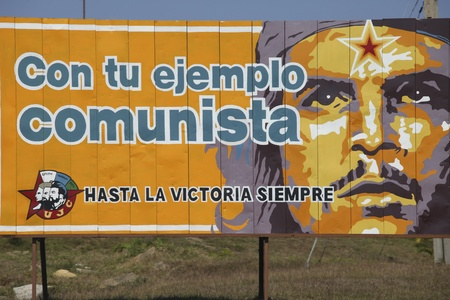 propaganda: CUBA - Feb 26: Propaganda billboard near the road  Feb 26, 2011 in  Cuba. The billboard depicts revolutionary Che Guevarra saying: with your example of communism, until the victory always.  Editorial