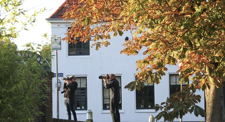 telezoom: NETHERLANDS, OCT 15: Wedding photographers at work with telezoom lenses in dutch village of Naarden on Oct 15, 2011