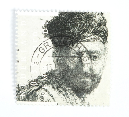 etch: THE NETHERLANDS - CIRCA 2006: A Dutch stamp issued in 2006 showing the 1631 etch by Rembrandt  Man with beard in eastern clothing which is presumed to be his father , circa 2006