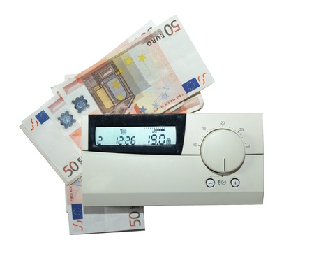 Many fifty euro bills behind a thermostat