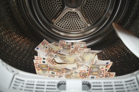 Euros inside washing machine. Concept for money laundering photo