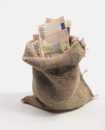 Jute bag with money in euros photo
