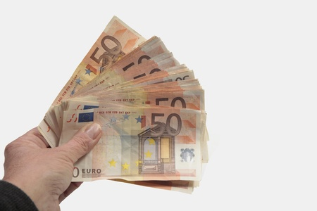 Big pack of fifty euro bills in hand photo