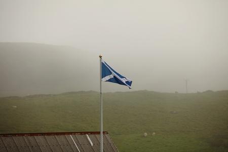 scot: Scottish flag in foggy scottish landscape