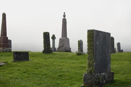 Fog  on a graveyard Scotland photo