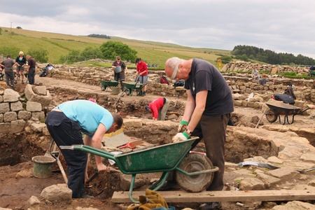 archaeologists: ROMAN VINDOLANDA-ENGLAND - JULY 12: Unidentified archaeologists & summer students participate in excavations at an ancient Roman fort & settlement in Roman Vindolanda near Hadrians wall in Great Britain on July 12, 2011.  Editorial