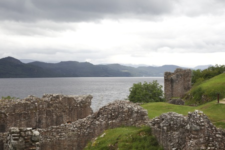 Ruins of ancient medieval Urquhart castle on the shore of Loch Ness in Scotland