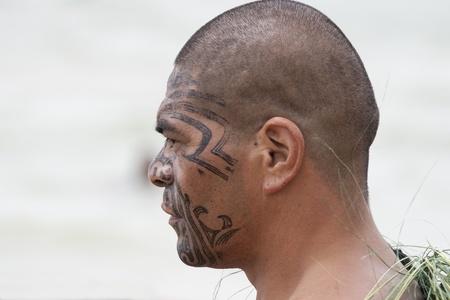 tattoo face: NEW ZEALAND-FEB 6:Maori warrior with fake tattoo at a Haka on Waitangi Day celebration,Feb 6, 2009. Waitangi day is a public holiday,yearly on Feb 6 to celebrate the signing of the Treaty of Waitangi Editorial