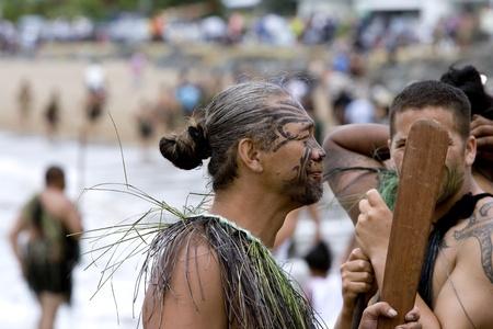 tattoo face: NEW ZEALAND-FEB 6:Maori warrior with a taiaha at a Haka on Waitangi Day celebration,Feb 6, 2009. Waitangi day is a public holiday,yearly on Feb 6 to celebrate the signing of the Treaty of Waitangi Editorial