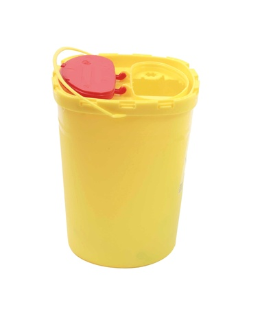 disposal: Yellow plastic container for disposable medicine and syringes Stock Photo