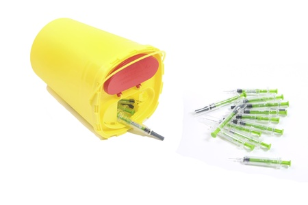 waste prevention: THE NETHERLANDS- JAN 27: Container for disposable syringes with a heap of used syringes. Medicine is  Fraxiparine used to prevent trombosis