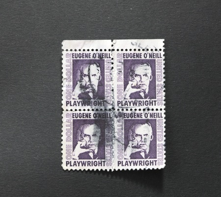 laureate: UNITED STATES OF AMERICA - CIRCA 1973: A block of four identical stamps printed in the United States of America showing Eugene O?Neill, American playwright and Nobel laureate in Literature, circa 1973