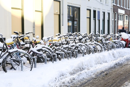 A row of snow covered bikes in the Dutch town of Groningen photo