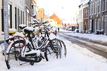 groningen: Row of bikes in the snow in Dutch Groningen Stock Photo