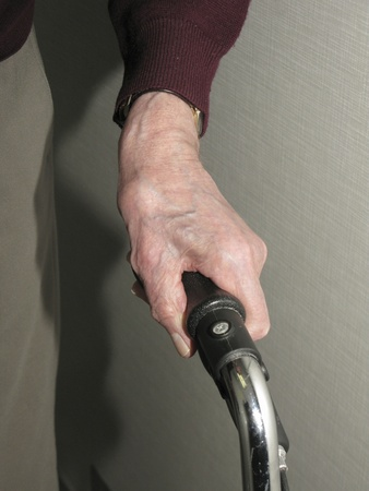 dexterity: Close up of the hand of a senior holding on to the grip of a wheeled walker