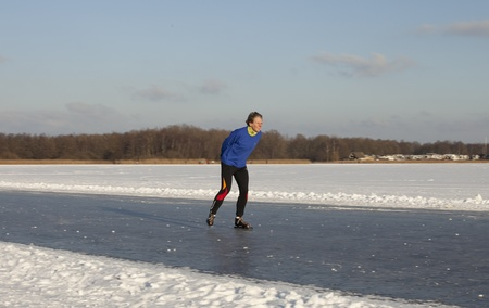 THE NETHERLANDS-FEB 9: Dutch ice skater practices for the famous 150 kilometer Noorderrondrit  on natural ice on february 9, 2012 in Groningen. This february  temperatures dropped in the netherlands to an exceptionally low - 20 ¡C Stock Photo - 12257970