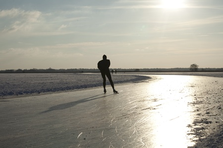 THE NETHERLANDS-FEB 9: Dutch ice skater practices for the famous 150 kilometer Noorderrondrit  on natural ice on february 9, 2012 in Groningen. This february  temperatures dropped in the netherlands to an exceptionally low - 20 �C Stock Photo - 12257984