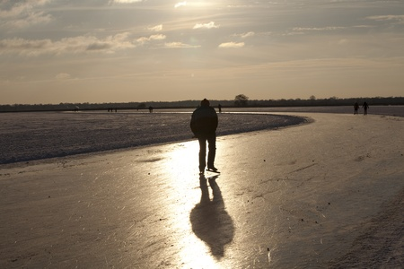 exceptionally: THE NETHERLANDS-FEB 9: Speed skater practices for the famous 150 kilometer Noorderrondrit that will be held on February 11, 2012 in Groningen. This february  temperatures dropped in the netherlands to an exceptionally low - 20 �C