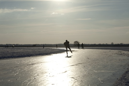 THE NETHERLANDS-FEB 9: Ice skaters on frozen lake practising for the