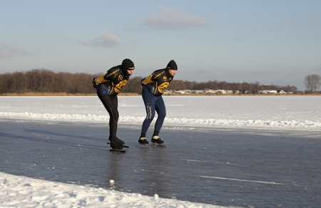 THE NETHERLANDS-FEB 9: Ice skaters on frozen lake practising for t the