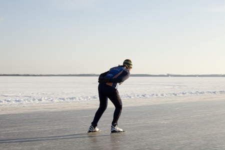 THE NETHERLANDS-FEB 9: Female speed skater practices for the famous 150 kilometer Noorderrondrit  on natural ice on February 9, 2012 in Groningen. This february  temperatures dropped in the netherlands to an exceptionally low - 20 �C Stock Photo - 12257977