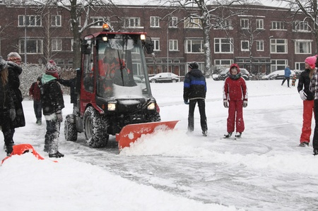 THE NETHERLANDS-FEB 3: Snow shovel at work on natural outdoor ice skating rink in the Netherlands on Feb 3, 2012.  February is the coldest month throughout the Netherlands with an average of -0.5¡C. This february temperatures dropped to a minus 20 ¡C  Stock Photo - 12280325