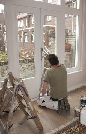 Painter paints woodwork photo