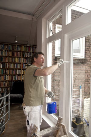 Painter painting inside of door in living room Stock Photo - 12433671