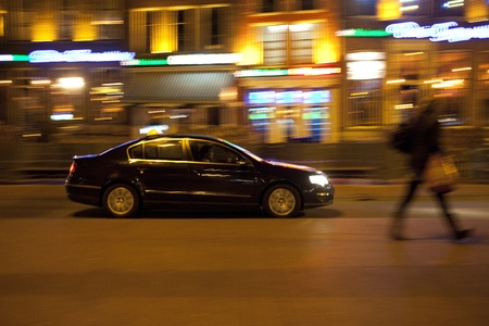 Car at night in Dutch city with motion blur photo