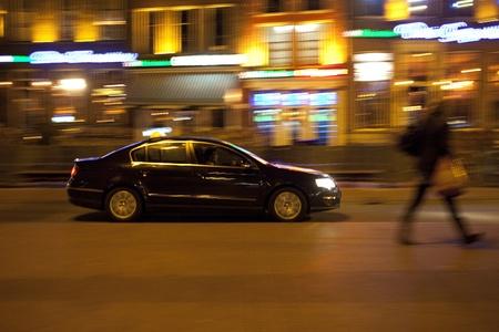 hybrid car: Car at night in Dutch city with motion blur