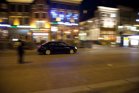 Taxi on the street at night in a Dutch city photo