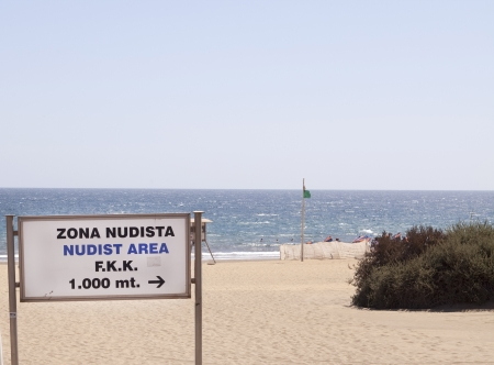 nudism: A sign indicating the direction of a nudist beach on Spanish Gran Canaria Stock Photo