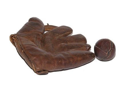 old items: Vintage leather baseball glove and ball on white