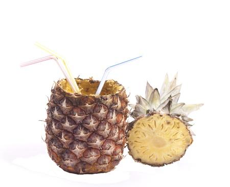 Pineapple with three straws on white photo