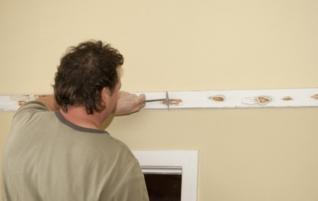 stripping: Stripping paint from wooden ledge