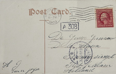 Vintage postcard with red two cent stamp and postmarked Hoboken in 1909. Address in Rotterdam, the Netherlands  Editorial