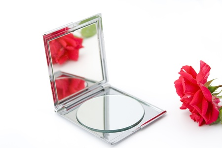 rose and mirror with reflection of the rose  photo