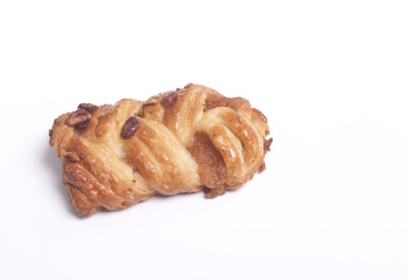 Sweet danish pecan pastry on white photo