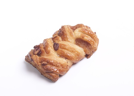 Sweet danish pastry with pecan nuts on white photo