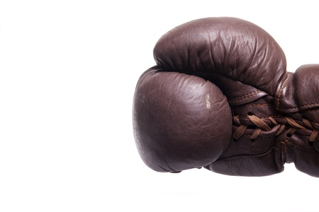 blow out: Punch by a brown vintage boxing glove Stock Photo