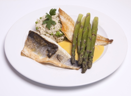 safran: Seabass with asparagus and risotto on a safran sauce Stock Photo