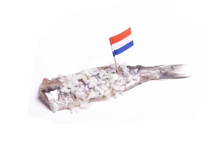 Traditonal Dutch delicacy is new raw  herring with onions Standard-Bild