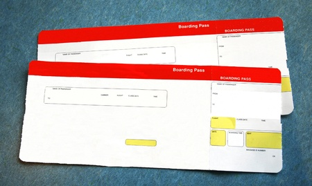 two red and white boarding passes. Information is removed photo