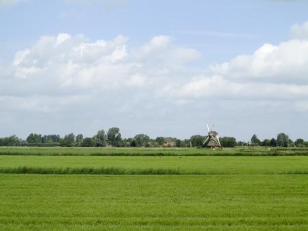 Windmill in Dutch landscape near Groningen Stock Photo - 14286881