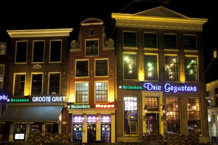 GRONINGEN, THE NETHERLANDS-MARC 8: rows of bars and restaurants in the old center of Groningen on March 3, 2012. The old center of university town Groningen is famous for its bars and nightlife for students