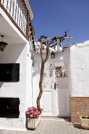 Exterior of a typical white spanish house with blue sky photo